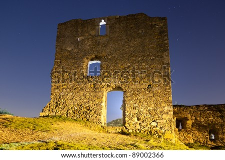 Low-angle shoot of old ruins of a castle at night - stock photo