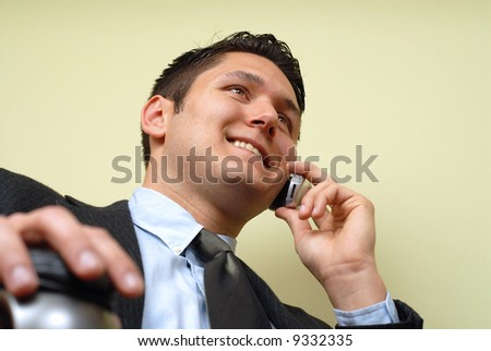 Low angle shot of a busy professional sitting at the office and talking - stock photo