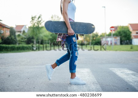 Low angle shot of a girl with a skate.
