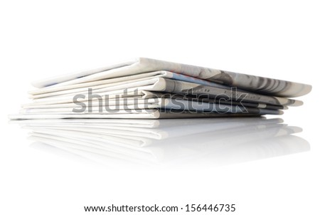 low angle shot of a pile on news papers isolated on a white background - stock photo