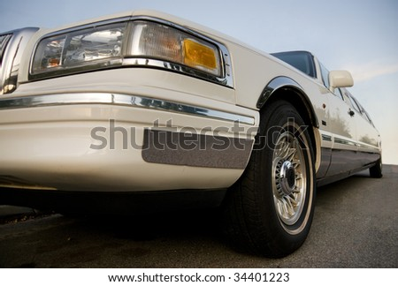 Low angle shot of a white limousine - stock photo