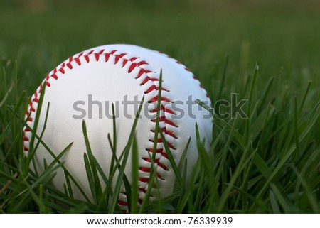 Low angle shot of Baseball in Grass