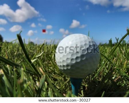 Low angle shot of golf ball - stock photo