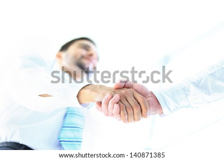 Low angle-shot of shake hands - stock photo