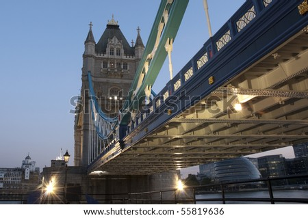 Low angle shot of Tower Bridge detail in London at dusk. - stock photo