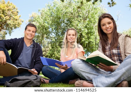 Low angle-shot of young people working in a park - stock photo