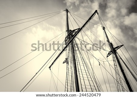 Low angle take of sailboat masts and rigging - stock photo