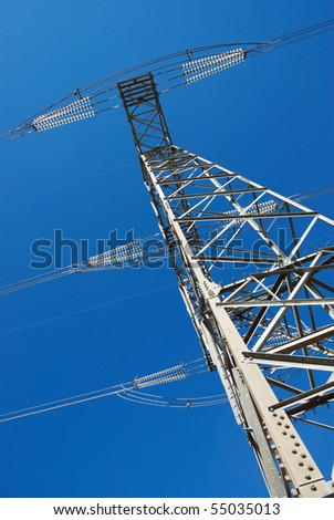 low angle view for electricity pylon against blue sky - stock photo