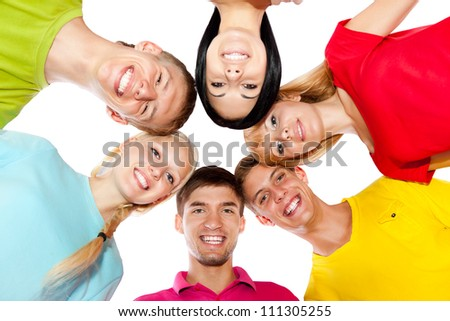 Low angle view group of young people, students happy smile standing in circle looking down at camera, isolated over white background