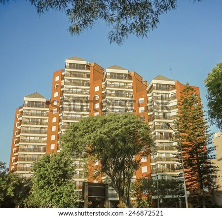 Low angle view modern apartments building in one of the most luxury zones of Montevideo, the capital city of Uruguay in South America. - stock photo