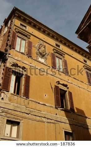 Low angle view of a country building, Siena, Tuscany, Italy, - stock photo