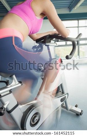 Low angle view of a determined young woman working out at  class in gym - stock photo
