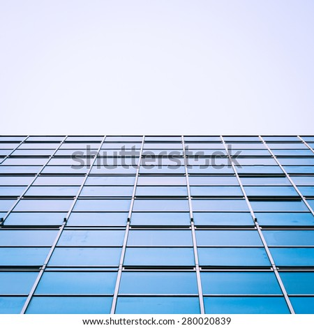 Low angle view of a glass and steel skyscraper giving the appearance of a futuristic horizon landscape.