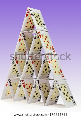 Low-angle view of a house of cards - stock photo