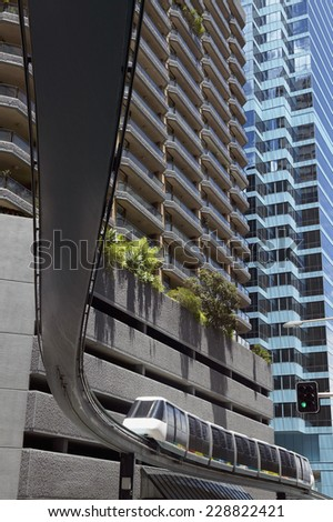 Low angle view of a monorail in an urban setting - stock photo