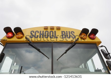 Low angle view of a school bus against sky - stock photo