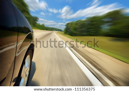 Low angle view of a vehicle traveling on the expressway. Sunny day - stock photo