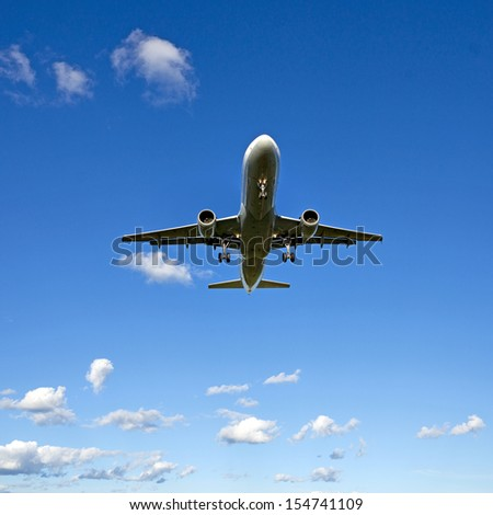low angle view of aircraft on blue sky - stock photo