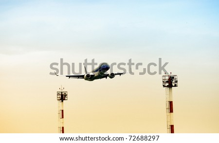 Low angle view of airplane landing process. Beautiful photograph for your brochure about safety, transportation or travel. - stock photo