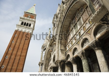 Low angle view of bell tower and facade of St Mark's Basilica. Horizontal shot. - stock photo