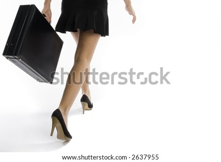 low angle view of business woman walking with briefcase - stock photo