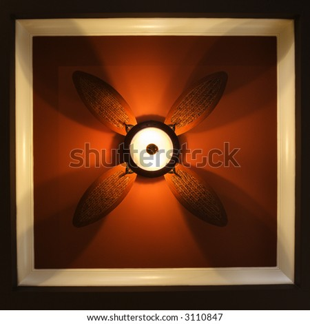 Low angle view of ceiling fan lamp.