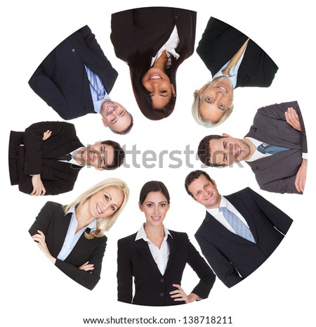 Low angle view of diverse group of business people. Isolated on white - stock photo