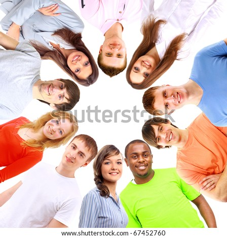 Low angle view of happy men and women standing together in a circle - stock photo