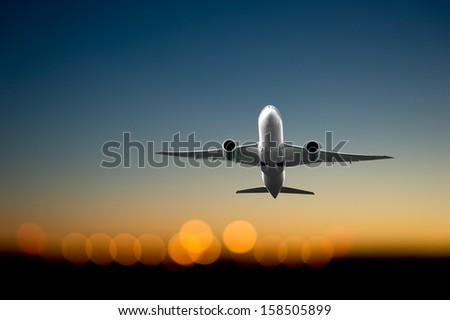 Low angle view of jet  airliner taking off - stock photo