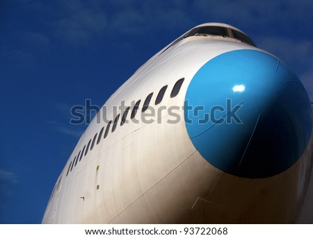 Low angle view of jumbo jet ready for takeoff - stock photo