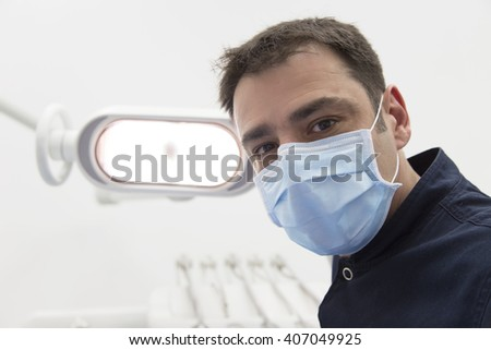 Low angle view of male dentist ready for dental examination