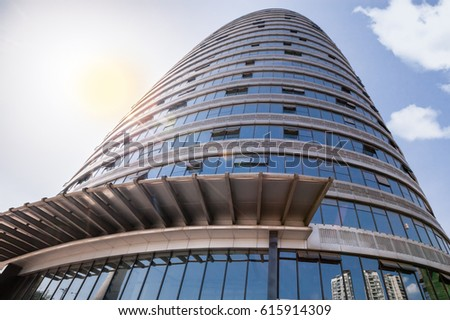 low angle view of modern office building exterior with sunshine