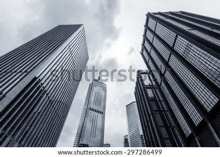 low angle view of modern skyscraper exterior and sky - stock photo