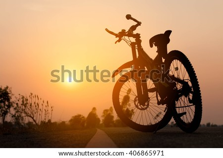 low angle view of mountain bike on trail at sunrise