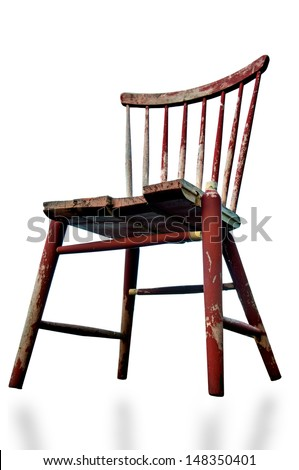 Low angle view of old tatty wooden chair isolated on white