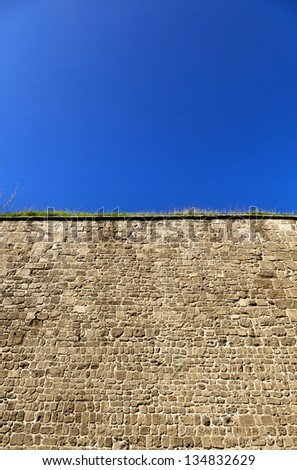 Low angle view of part of a stone wall, located at the old city of Acco, Israel. - stock photo