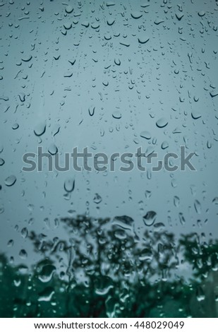 Low angle view of rain on glass, water on glass