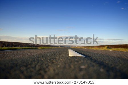 Low angle view of road with shallow depth of field and copy-space.
