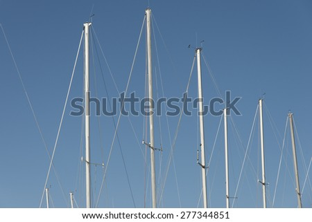 Low angle view of sailboat masts, Riverton, Hecla Grindstone Provincial Park, Manitoba, Canada - stock photo