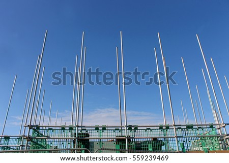 Low angle view of scaffolding poles on building site.