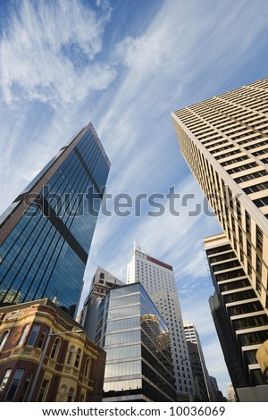 Low angle view of skyscrapers and buildings in downtown Sydney, Australia. - stock photo