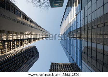 Low angle view of skyscrapers in downtown Chicago, Illinois. - stock photo