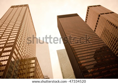 Low angle view of skyscrapers in Manhattan, New York City, NY, USA - stock photo
