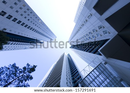 Low angle view of tall modern buildings - stock photo