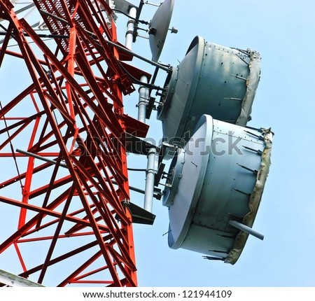 low angle view of  telecommunications towers against the sky - stock photo