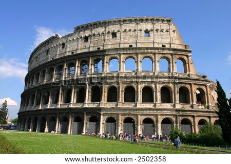 Low Angle view of the Colosseum Amphitheater in Rome against blue sky background.
