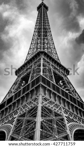 Low angle view of the Eifel Tower on a cloudy day