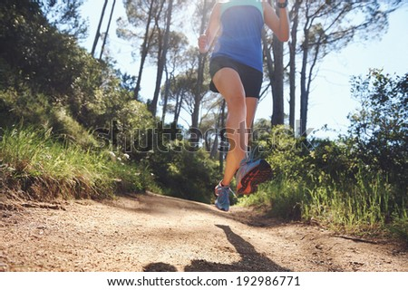 low angle view of trail runner exercising for marathon - stock photo