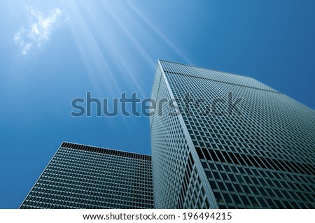 Low angle view of two tall buildings with lots of windows. - stock photo