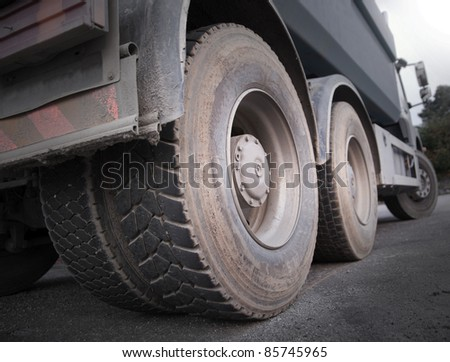 Low angle view of wheels of heavy truck